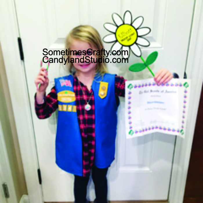 Girl Scout Daisy with her Large Felt Daisy Investiture Gift